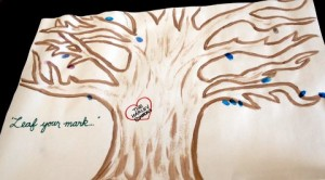 """Leaf your Mark"" oak tree with thumbprint ""leaves"" of everyone who came through"