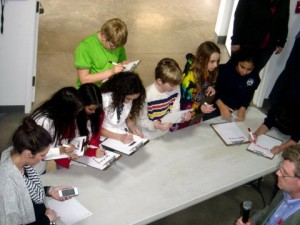 The 6th and 5th grade teams writing the first three US states alphabetically