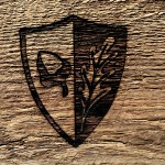 "Harley crest ""cut"" into vintage barn beam. Classic Commons creation!"